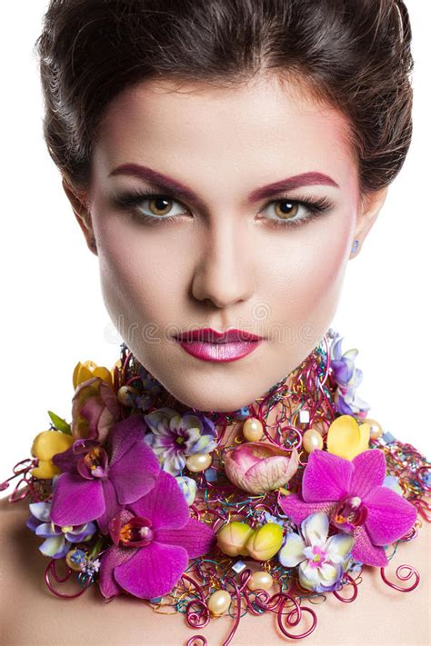 Fashion Beauty Woman With Flowers In Her Hair And Around